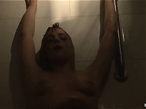 light-haired honey Dahlia teases and masturbates in the douche