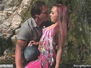Exotic porno with a red-haired tanned latina near a waterfall