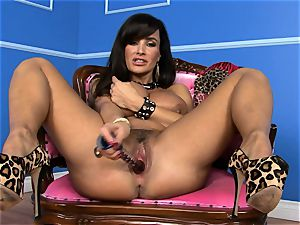 magnificent Lisa Ann inserts her fake penis deep in her humid pussy