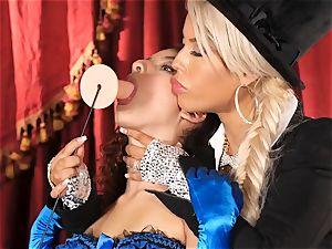 Bridgette B puts warm assistant Lana Lovelace through her paces