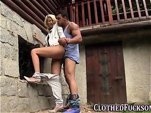 clothed ash-blonde gets jism